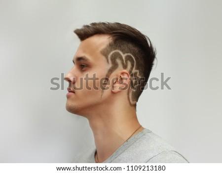 profile of a man's haircut tattoo