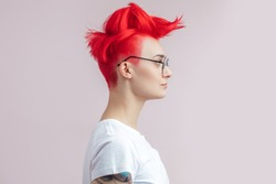 profile of a pretty hipster witn tattoo. people, fashion. style concept