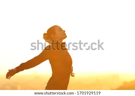 Profile of a runner resting breathing deeply fresh air outstretching arms at sunset Photo stock ©