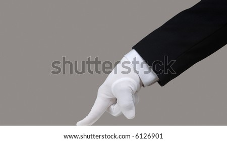 Profile of a white glove running a finger across a clean surface