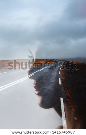 Profile of a young beautiful woman and the road, double exposure. Goal setting and dreams, concept.