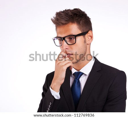 profile of a young business man thinking