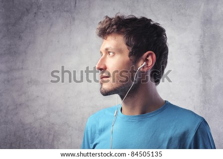 Profile of a young man listening to music