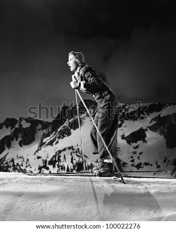 Profile of a young woman skiing