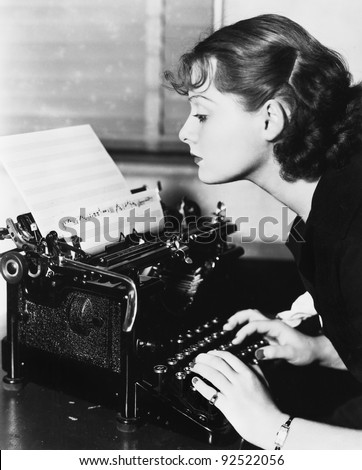 Profile of a young woman typing musical notes with a typewriter