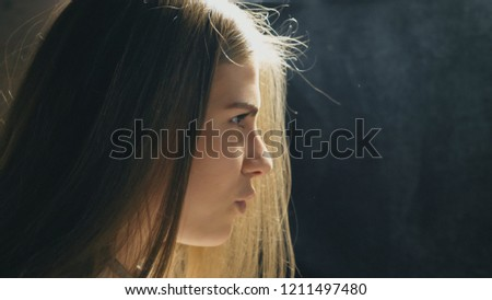 Profile of beautiful girl singing in sound studio. Young singer emotionally sings song. Working of creative musician. Show business concept. Slow motion Close up. #1211497480