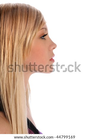 Profile of beautiful young woman isolated over white background