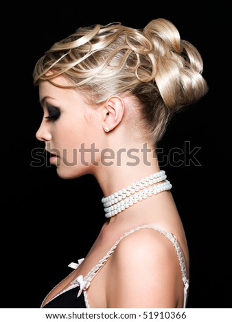 Profile of beautiful young woman with fashion hairstyle