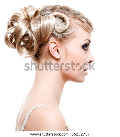 Profile of beautiful young woman with fashion hairstyle - on white background