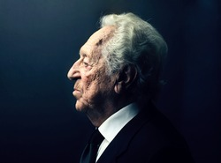 profile of elderly businessman