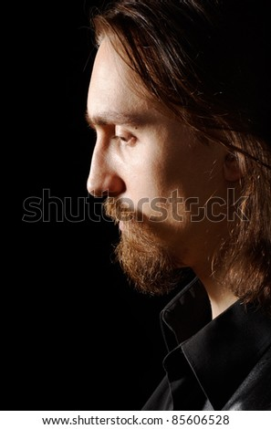 profile of handsome man looking down