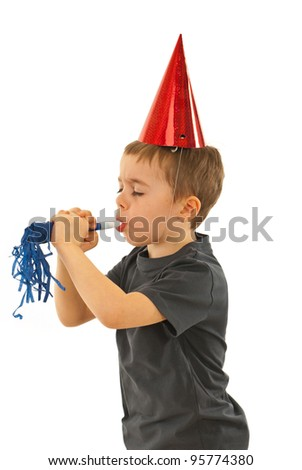 Profile of little boy with party hat  strong blowing in a noise maker and holding his eyes closed isolated on white background