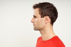 Profile of man in red shirt