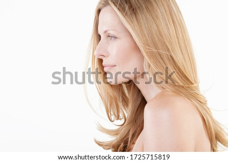 Profile of mid adult woman against white background