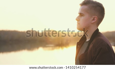 Profile of pensive handsome young man enjoying nature, summer adventure. #1410254177