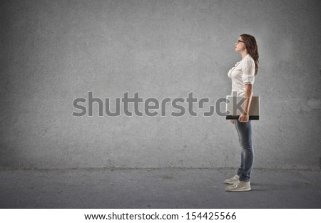 profile of student with laptop on a gray background