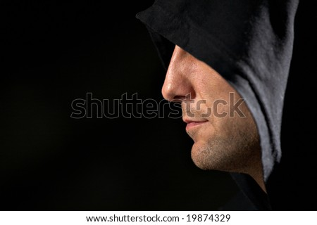 Profile Of The Man In A Hood On A Black Background Stock Photo 19874329 : <b>...</b> - stock-photo-profile-of-the-man-in-a-hood-on-a-black-background-19874329