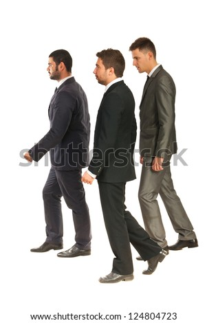 Profile of three business men walking  to work isolated on white background