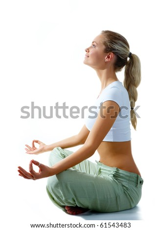 Profile of woman meditating in pose of lotus in isolation