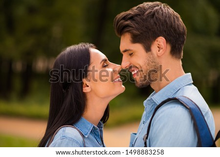 Profile photo of amazing pair going to kiss contacting noses closing eyes wear denim outfit #1498883258