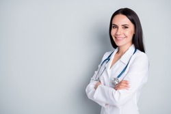 Profile photo of attractive family doc lady patients consultation friendly smiling reliable virology clinic arms crossed wear white lab coat stethoscope isolated grey color background