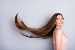 Profile photo of attractive model lady look demonstrate ideal neat long healthy hairstyle flying on air after lamination procedure wear beige singlet isolated grey color background