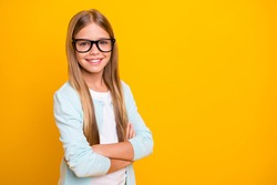 Profile photo of beautiful little blond lady hold arms hands crossed diligent student pupil 1 september school girl wear specs casual shirt isolated yellow bright color background
