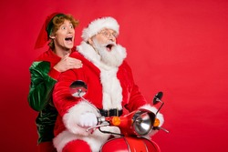 Profile photo of elf santa ride moped open mouth look empty space wear x-mas costume coat cap isolated red color background