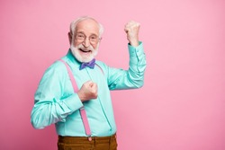 Profile photo of funky crazy grandpa raise fists ecstatic good mood cool achievement wear specs mint shirt suspenders violet bow tie trousers isolated pink pastel color background