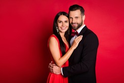Profile photo of optimistic cute couple hug look wear suit dress isolated on red color background