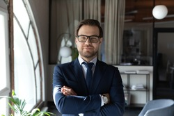 Profile picture of confident young caucasian businessman in formal suit and glasses posing in office, portrait of successful male boss or director show confidence and leadership, recruitment concept