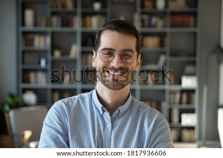 Profile picture of happy young Caucasian man in spectacles show confidence and leadership. Headshot portrait of smiling millennial male in glasses posing indoors at home. Employment, success concept.