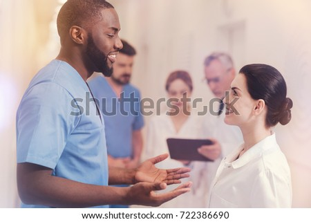 Profile picture of two medical workers while speaking