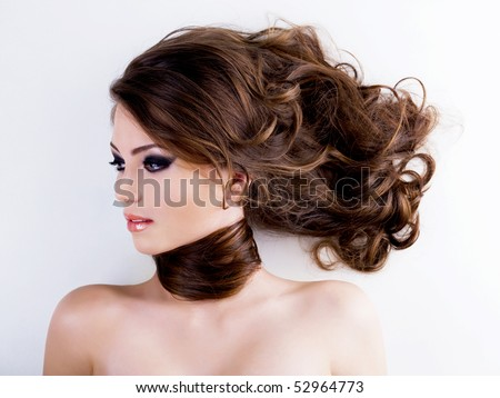Profile Portrait of a beautiful  woman with  long curly hairs