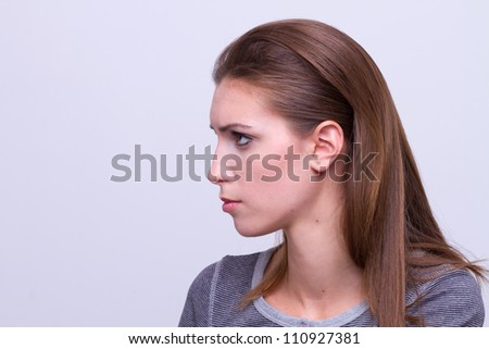 profile portrait of a young beautiful woman