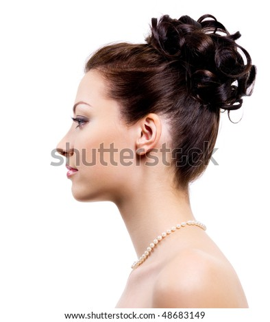 stock photo Profile portrait of an young bride with wedding hairstyle on