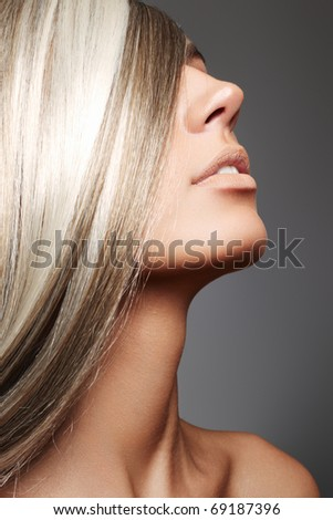 Profile portrait of female with long health beautiful hair. Beautiful model face with perfect straight shiny hair. Smooth hairstyle. - stock photo