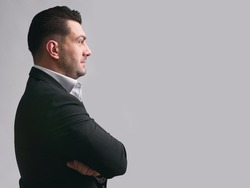 profile portrait of handsome businessman. Isolated on grey with copy space