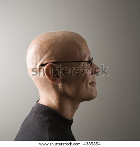 Profile portrait of mid-adult Caucasian male. - stock photo