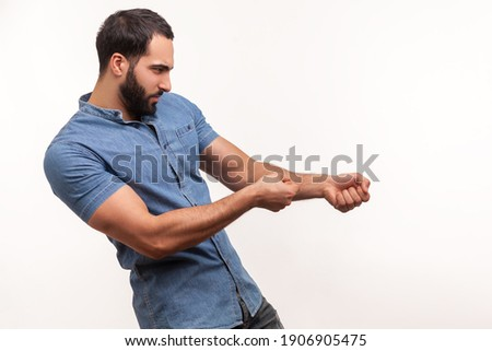 Profile portrait strong assertive man purposeful businessman with beard pulling invisible rope, showing his persistence and leadership qualities. Indoor studio shot isolated on white background Stock photo ©