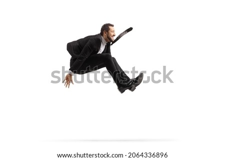 Profile shot of a businessman jumping isolated on white background