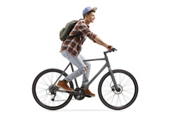 Profile shot of a male student riding a bicycle isolated on white background
