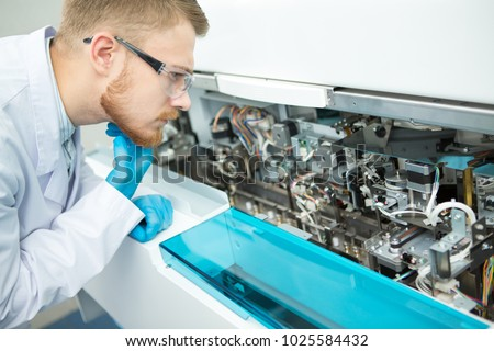 Profile shot of a thoughtful male medical practitioner examining laboratory equipment machine copyspace machinery technology repairman fix problem broken immunochemistry analyzer staff technician.