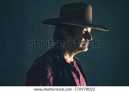 Profile shot of retro 1960s cowboy actor. #576978022