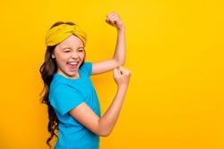 Profile side photo of positive cheerful girl kid enjoy rejoice celebrate corona virus epidemic victory raise fists scream yes wear stylish trendy clothes isolated bright color background