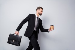 Profile side photo of serious worker man late work rest relax time hurry workplace hold espresso beverage mug briefcase wear black pants jacket blazer isolated grey color background