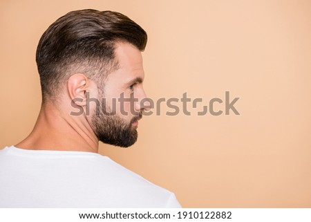 Profile side photo of young bristle handsome man serious look empty space isolated over beige color background Сток-фото ©