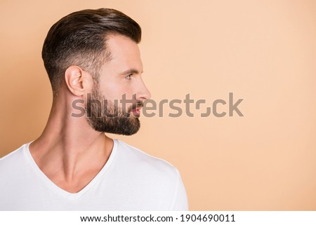 Profile side photo of young handsome bristle man confident look empty space isolated over beige color background Сток-фото ©