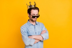 Profile side photo of young serious man confident crossed hands wesr crown prince royal isolated over yellow color background