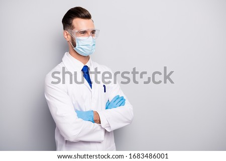 Profile side portrait of his he nice attractive cheerful experienced doc scientist dentist surgeon apothecary physicist folded arms isolated on light white gray pastel color background